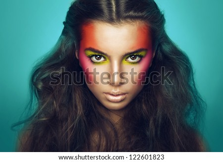 serious girl with eye shadows on face - stock photo
