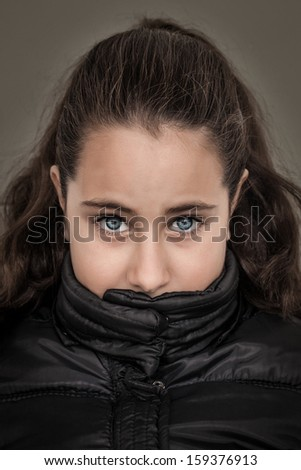 Serious Girl with Her Mouth Covered - stock photo