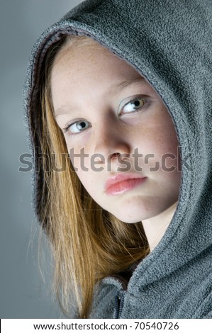 serious girl with pretty eyes - stock photo