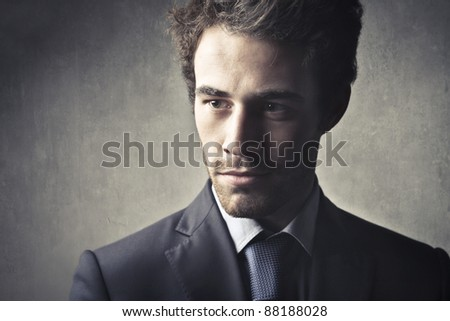Serious handsome businessman - stock photo