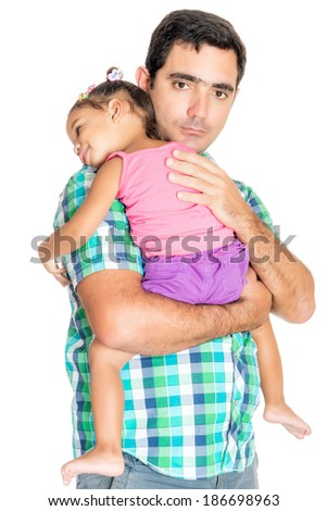 Serious hispanic father carrying his tired small daughter isolated on white - stock photo