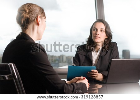 Serious job interview of a woman with a business recruiter - stock photo