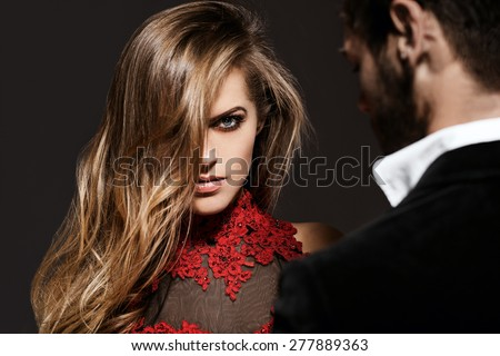 Serious look woman. Sexy elegant couple in the tender passion. - stock photo