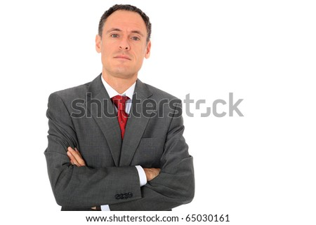 Serious looking businessman. All on white background - stock photo