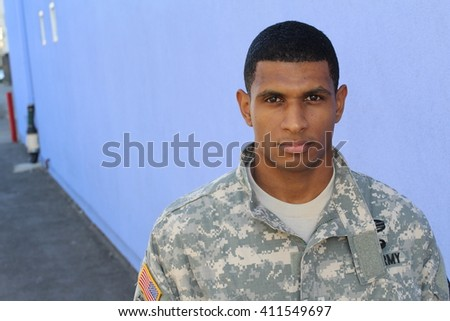 Serious looking serviceman with copy space on the left - stock photo