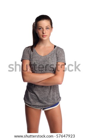 Serious looking teenager in shorts - stock photo