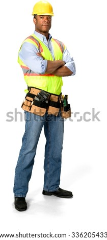 Serious Male Construction Worker with short black hair in uniform with arms folded - Isolated - stock photo