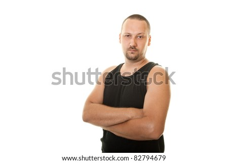 serious man in a black undershirt - stock photo