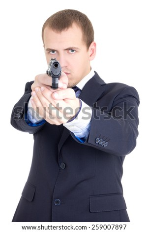 serious man in business suit aiming gun isolated on white background - stock photo