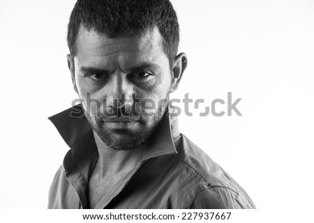 serious man looking to camera - stock photo