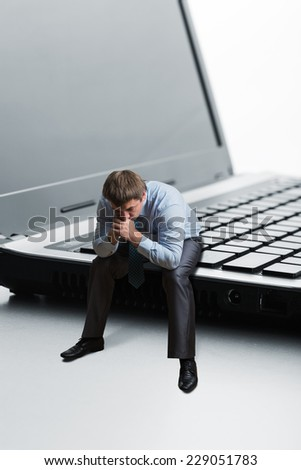 Serious man thinks - stock photo