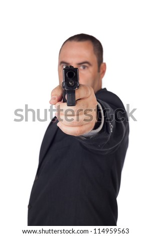 Serious man with a gun ready to shoot - stock photo