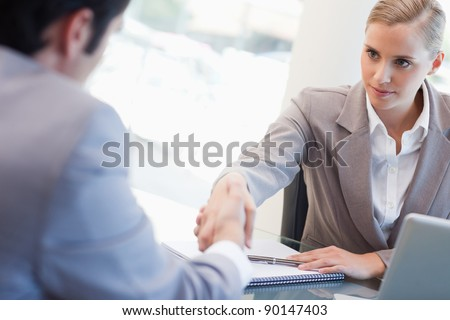Serious manager interviewing a male applicant in her office - stock photo