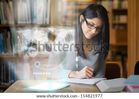 Serious mature student studying international trade on digital interface in university library - stock photo