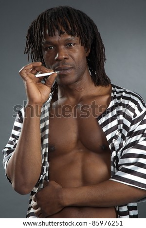 Serious men afro-american pose on gray background - stock photo