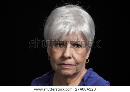 Serious portrait of a mature woman  - stock photo