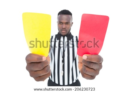 Serious referee showing yellow and red card on white background - stock photo