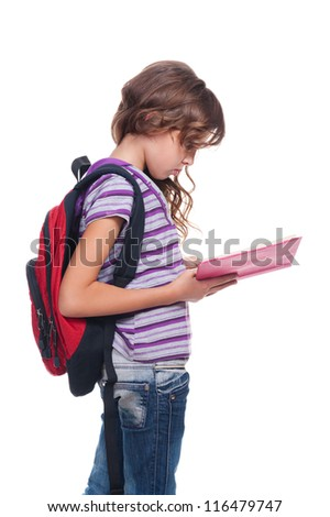 serious schoolgirl reading the book. isolated on white background - stock photo