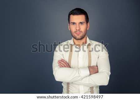 Serious strict man with crossed hands - stock photo