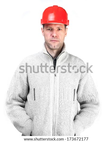 Serious worker man in a red helmet and jacket - stock photo