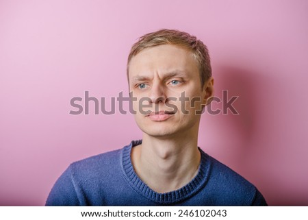 Serious young blond man on. Photo Shoot. - stock photo