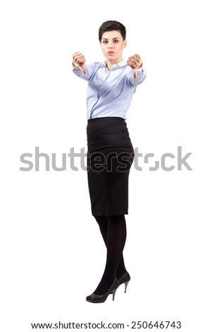 Serious young business woman showing thumbs down gesture. Full body length portrait isolated over white background. - stock photo