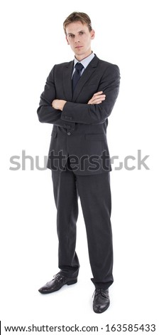 Serious young businessman in suit full length - stock photo