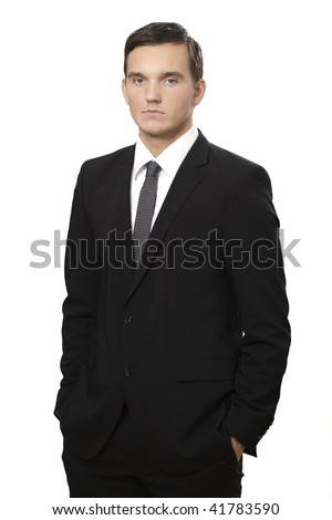 serious young businessman standing against isolated white background - stock photo