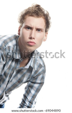 serious young man looking straight over white - stock photo