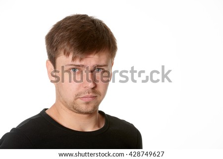 Serious young man, questioning expression,horizontal  on white background with space for text - stock photo
