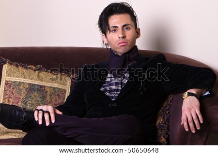 Serious Young Man Resting in a Luxury Living Room. - stock photo