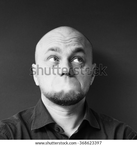 Serious young man without a mouth.  - stock photo