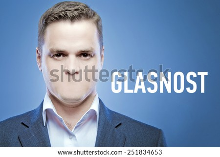 Serious young man without a mouth on a blue background with the words: Glasnost - stock photo