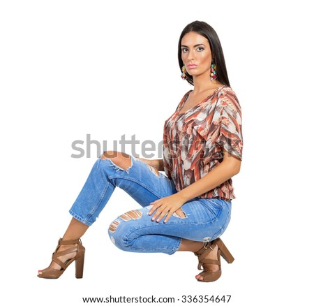 Serious young sensual brunette fashion model posing at camera. Full body length portrait isolated over white studio background.  - stock photo