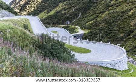Serpentines of the road Tremola to the pass Gotthard in Tessin, Switzerland - stock photo