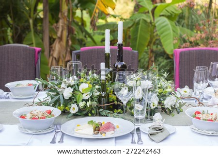 served and decorated wedding table in a rustic style - stock photo
