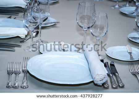 served banquet table set at restaurant - stock photo