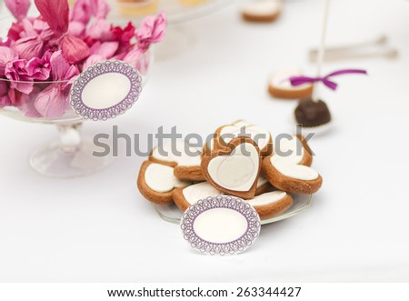 Served festive candy bar table with biscuits and other desserts - stock photo