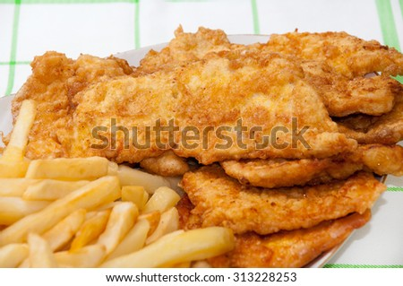 Served fried chicken breast and french fries. - stock photo