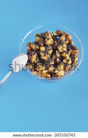 Served funnel cake with caramel and poppy seeds - stock photo