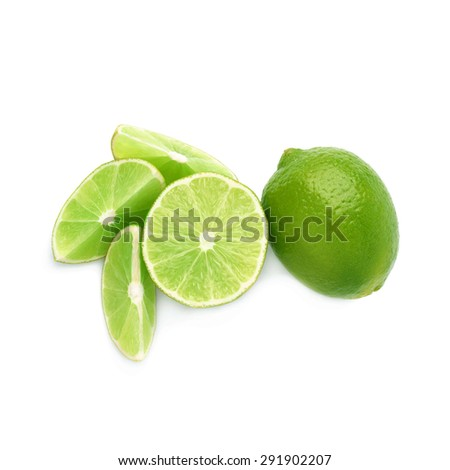 Served lime fruit composition isolated over the white background, top view - stock photo