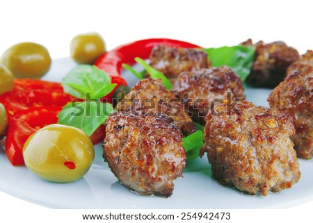 served meat cutlets with basil and tomatoes - stock photo