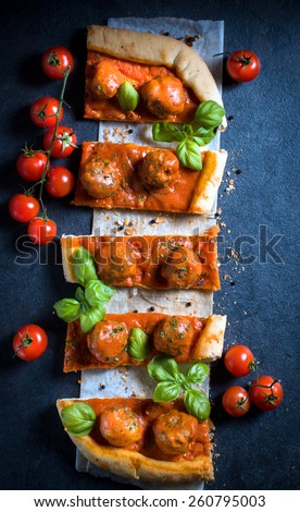 Served meatballs pizza on dark background from above,selective focus  - stock photo