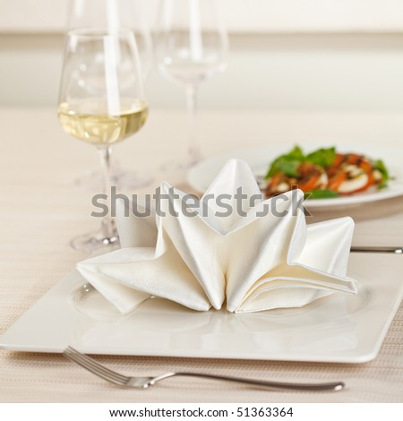 Served Place Setting with White Wine Glass - stock photo