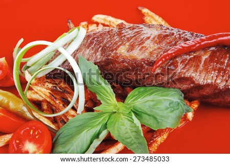 served roasted beef meat steak on potatoes over red dish isolated over white - stock photo