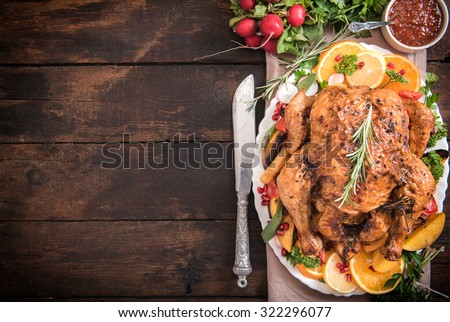 Served split roasted stuffed small turkey and vegetables,from above and blank space  - stock photo
