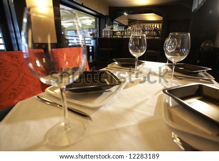 Served table at th restaurant ion front of the bar - stock photo