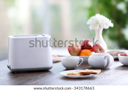 Served table for breakfast with toast and fruit, close-up - stock photo