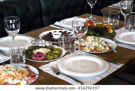 served table for dinner in the cafe - stock photo