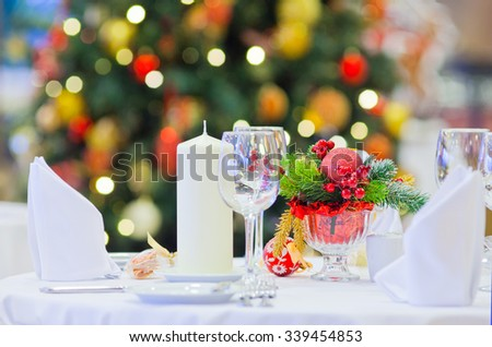 served table in home decorated for Christmas - stock photo